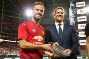Juan Mata #8 of Manchester United poses with Karger David Kohler President and CEO of Kohler Company after the International Champions Cup game against the Club America at the University of Phoenix Stadium on July 19, 2018 in Glendale, Arizona.