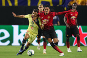 Henry Martin #21 of Club America and Chris Smalling #12 of Manchester United battle for the ball during the International Champions Cup game at the University of Phoenix Stadium on July 19, 2018 in Glendale, Arizona.