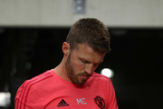 Michael Carrick of Manchester United signs an autograph prior to the International Champions Cup game against Club America at the University of Phoenix Stadium on July 19, 2018 in Glendale, Arizona.
