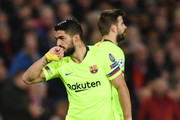 Luis Suarez of Barcelona celebrates as a Luke Shaw own goal gives his side the lead during the UEFA Champions League Quarter Final first leg match between Manchester United and FC Barcelona at Old Trafford on April 10, 2019 in Manchester, England.