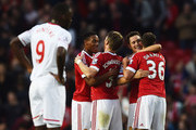Anthony Martial, Bastian Schweinsteiger, Ander Herrera and Matteo Darmian of Manchester United celebrate victory after the Barclays Premier League match between Manchester United and Liverpool at Old Trafford on September 12, 2015 in Manchester, United Kingdom.
