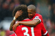 Ashley Young of Manchester United (R) congratulates goalscorer Marouane Fellaini as he scores their second goal during the Barclays Premier League match between Manchester United and Manchester City at Old Trafford on April 12, 2015 in Manchester, England.