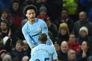 Manchester City's German midfielder Leroy Sane (top) and Manchester City's Belgian midfielder Kevin De Bruyne (C) celebrate after Manchester City's Spanish midfielder David Silva (L) scored the opening goal during the English Premier League football match between Manchester United and Manchester City at Old Trafford in Manchester, north west England, on December 10, 2017. / AFP PHOTO / Oli SCARFF / RESTRICTED TO EDITORIAL USE. No use with unauthorized audio, video, data, fixture lists, club/league logos or 'live' services. Online in-match use limited to 75 images, no video emulation. No use in betting, games or single club/league/player publications.  /