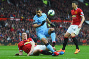 Sergio Aguero of Manchester City is challenged by Phil Jones of Manchester United during the Barclays Premier League match between Manchester United and Manchester City at Old Trafford on April 12, 2015 in Manchester, England.