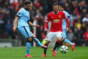 Gael Clichy of Manchester City is watched by Juan Mata of Manchester United during the Barclays Premier League match between Manchester United and Manchester City at Old Trafford on April 12, 2015 in Manchester, England.