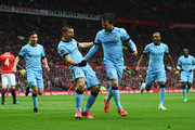 Sergio Aguero of Manchester City (3L) celebrates with David Silva (3R) and team mates as he scores their first goal during the Barclays Premier League match between Manchester United and Manchester City at Old Trafford on April 12, 2015 in Manchester, England.