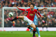 Ander Herrera of Manchester United shields the ball from Fernandinho of Manchester City during the Barclays Premier League match between Manchester United and Manchester City at Old Trafford on April 12, 2015 in Manchester, England.