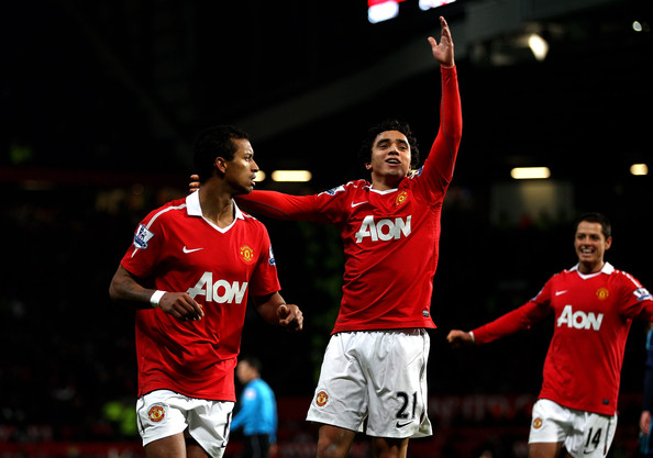 Nani (L) of Manchester United celebrates scoring his team's second goal with team mate Rafael during the Barclays Premier League match between Manchester United and Stoke City at Old Trafford on January 4, 2011 in Manchester, England.