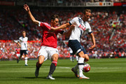 Harry Kane of Tottenham Hotspur and Matteo Darmian of Manchester United compete for the ball during the Barclays Premier League match between Manchester United and Tottenham Hotspur at Old Trafford on August 8, 2015 in Manchester, England.