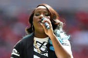 Singer Misha B performs ahead of the FA Community Shield match between Manchester United and Wigan Athletic at Wembley Stadium on August 11, 2013 in London, England.