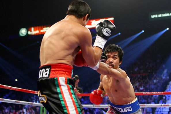Manny Pacquiao v Juan Manuel Marquez [combat sport,barechested,contact sport,professional boxer,sport venue,boxing ring,boxing glove,boxing,striking combat sports,professional boxing,juan manuel marquez,manny pacquiao,v,head,left,l-r,las vegas,nevada,mgm grand garden arena,welterweight bout]