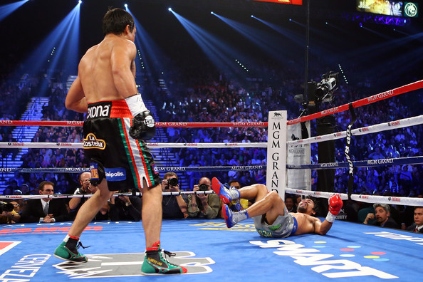 Manny Pacquiao v Juan Manuel Marquez [sports,contact sport,sport venue,professional boxer,boxing ring,boxing,combat sport,striking combat sports,boxing glove,barechested,juan manuel marquez,manny pacquiao,v,l-r,las vegas,nevada,mgm grand garden arena,round,welterweight bout]