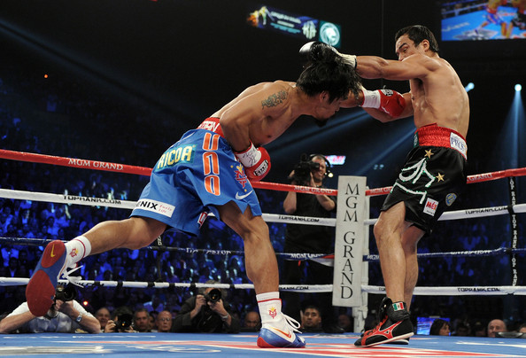 Manny Pacquiao v Juan Manuel Marquez [combat sport,sports,contact sport,boxing ring,sport venue,professional boxer,striking combat sports,boxing,muay thai,boxing glove,manny pacquiao,juan manuel marquez,v,body,left,l-r,mgm grand garden arena,wbo,round,world welterweight title fight]
