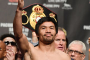 WBA welterweight champion Manny Pacquiao poses on the scale during his official weigh-in at MGM Grand Garden Arena on January 18, 2019 in Las Vegas, Nevada. Pacquiao will defend his title against Adrien Broner on January 19 at MGM Grand Garden Arena in Las Vegas.