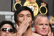WBA welterweight champion Manny Pacquiao blows a kiss to fans as he poses on the scale during his official weigh-in at MGM Grand Garden Arena on January 18, 2019 in Las Vegas, Nevada. Pacquiao will defend his title against Adrien Broner on January 19 at MGM Grand Garden Arena in Las Vegas.
