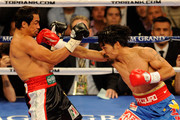 (R-L) Manny Pacquiao throws a right to the head of Juan Manuel Marquez during the WBO world welterweight title fight at the MGM Grand Garden Arena on November 12, 2011 in Las Vegas, Nevada.