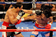 (L-R) Juan Manuel Marquez connects with a left to the head of Manny Pacquiao during the WBO world welterweight title fight at the MGM Grand Garden Arena on November 12, 2011 in Las Vegas, Nevada.