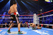 (L-R) Juan Manuel Marquez knocks down Manny Pacquiao in the third round during their welterweight bout at the MGM Grand Garden Arena on December 8, 2012 in Las Vegas, Nevada.