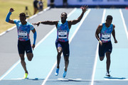 Paulo Andre de Oliveira of Brazil (L), runs against Justin Gatlin of the U.S. (C ) and Isiah Young of the U.S. during the 'Mano a Mano' Athletics Challenge' at the Brazilian Jockey Club on October 01, 2017 in Rio de Janeiro, Brazil.