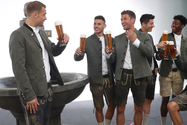 FC Bayern Muenchen And Paulaner Photo Session [suit,event,formal wear,white-collar worker,tourism,manuele neuer,david alaba,robert lewandowski,thomas mueller,lucas hernandez,l-r,fc bayern muenchen,paulaner,fgv schmidtle studios,photo session]