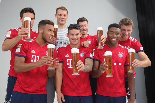 FC Bayern Muenchen And Paulaner Photo Session [team,social group,red,youth,competition event,player,championship,competition,cheering,event,niko kovac,partner,mats hummels,corentin tolisso,l-r,germany,fc bayern muenchen,paulaner,football team,photo session]