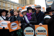 Protesters including actor Michael Sheen (2ndR), Helen Pankhurst (C), great-granddaughter of suffragette leader Emmeline Pankhurst and Labour Shadow Foreign Secretary Emily Thornberry (2ndL) gather outside the House of Parliament before marching to Trafalgar Square during the March4Women event on March 4, 2018 in London, England. Demonstrators march through central London today with calls for an end to gender-based discrimination in the workplace. The event celebrates the upcoming International Women's Day, on March 8th, and marks 100 years since the first women in the UK gained the right to vote.