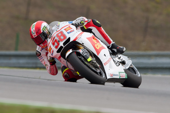 Marco Simoncelli Marco Simoncelli of Italy and San Carlo Honda Gresini rounds the bend  during the free practice of MotoGp of Czech Republic at Brno Circuit on August 12, 2011 in Brno, Czech Republic.