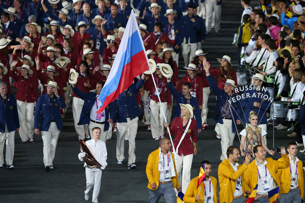 Maria Sharapova Maria Sharapova of the Russia Olympic tennis team carries her country's flag during the Opening Ceremony of the London 2012 Olympic Games at the Olympic Stadium on July 27, 2012 in London, England.