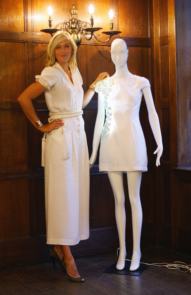 Maria Sharapova, international tennis star and global brand ambassador for Sony Ericsson poses with the winning design at Liberty store as she unveils winning designs from students at the London College of Fashion on June 17, 2009 in London, England.