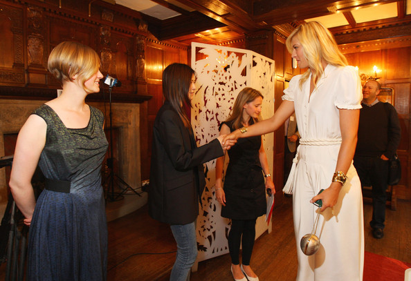 Maria Sharapova, international tennis star and global brand ambassador for Sony Ericsson meets with one of the winning students of London College of Fashion Cecilia Ku at Liberty store as she unveils winning designs from students at the London College of Fashion on June 17, 2009 in London, England.