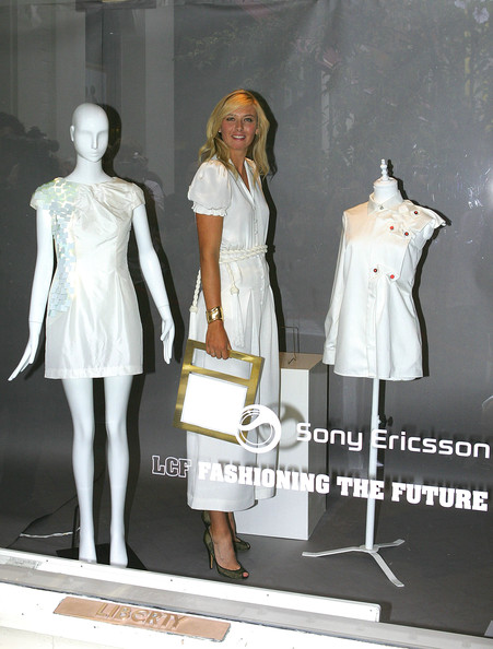 Maria Sharapova, international tennis star and global brand ambassador for Sony Ericsson, strikes a pose in the window of Liberty store as she unveils winning designs from students at the London College of Fashion on June 17, 2009 in London, England.