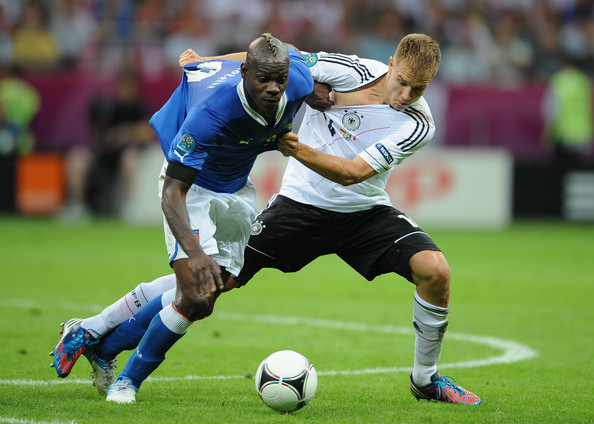 Mario Balotelli Mario Balotelli of Italy battles for the ball with  Holger Badstuber of Germany during the UEFA EURO 2012 semi final match between Germany and Italy at the National Stadium on June 28, 2012 in Warsaw, Poland.