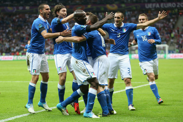 Mario Balotelli Mario Balotelli (3rd R) of Italy celebrates with team-mates after scoring the opening goal during the UEFA EURO 2012 semi final match between Germany and Italy at the National Stadium on June 28, 2012 in Warsaw, Poland.