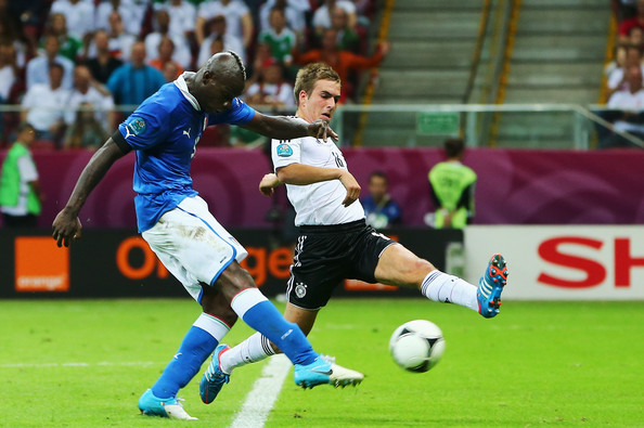 Mario Balotelli Mario Balotelli of Italy scores his team's second goal past Philipp Lahm of Germany during the UEFA EURO 2012 semi final match between Germany and Italy at the National Stadium on June 28, 2012 in Warsaw, Poland.