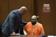 """Marion """"Suge"""" Knight, right, appears for a haring with his lawyer Matthew P. Fletcher at the Clara Shortridge Foltz Criminal Justice Center March 9, 2015 in Los Angeles, California.  The hearing was scheduled to determine if the two criminal cases against Knight, one for murder and attempted murder when Knight allegedly ran over two men in a Compton parking lot after an argument and another case involving an alleged robbery and criminal threats to a photographer in Beverly Hills, should be moved to the downtown Los Angeles courthouse."""