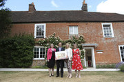 (L-R) Mary Macleod, a Conservative member of parliament, Governor of the Bank of England, Mark Carney, Stella Creasy, a Labour and Co-operative member of parliament, and Caroline Criado-Perez, co-founder of the Women's Room, pose following the presentation at the Jane Austen House Museum on July 24, 2013 in Chawton, near Alton, England. Jane Austen will appear on the United Kingdom's next 10 pound note, ensuring at least one female figure is represented on the currency in circulation.