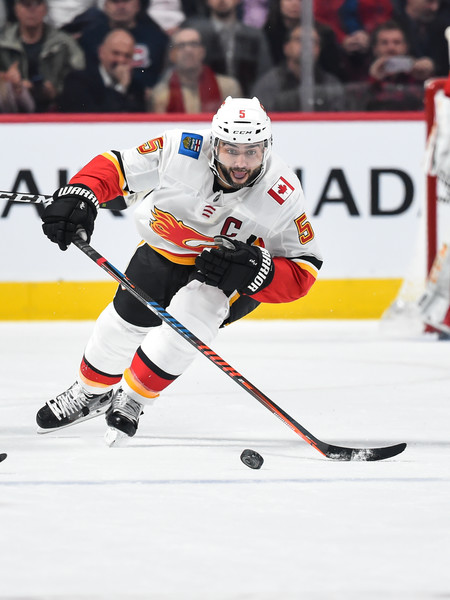 Calgary Flames vs. Montreal Canadiens [college ice hockey,ice hockey position,sports,sports gear,hockey protective equipment,ice hockey,ice hockey equipment,hockey,hockey pants,player,mark giordano,skates,puck,bell centre,canada,montreal,montreal canadiens,calgary flames,nhl,game]