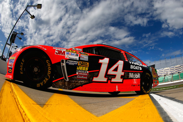Mark Martin pilots Tony Stewart's 14 car at Kansas