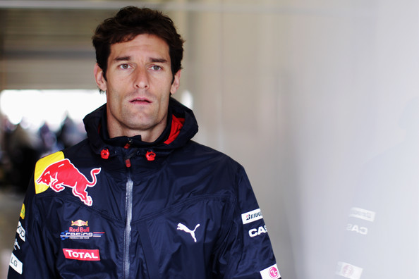 Mark Webber Mark Webber of Australia and Red Bull Racing walks in the pitlane on his way to attending the drivers parade before the Belgian Formula One Grand Prix at the Circuit of Spa Francorchamps on August 29, 2010 in Spa Francorchamps, Belgium.
