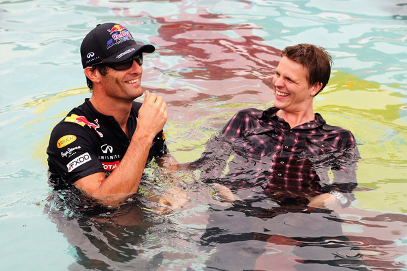 Mark Webber Mark Webber of Australia and Red Bull Racing and BBC TV F1 presenter Jake Humphrey end up in the Red Bull Energy Station pool while filming an interview during previews to the Monaco Formula One Grand Prix at the Monte Carlo Circuit on May 25, 2011 in Monte Carlo, Monaco.