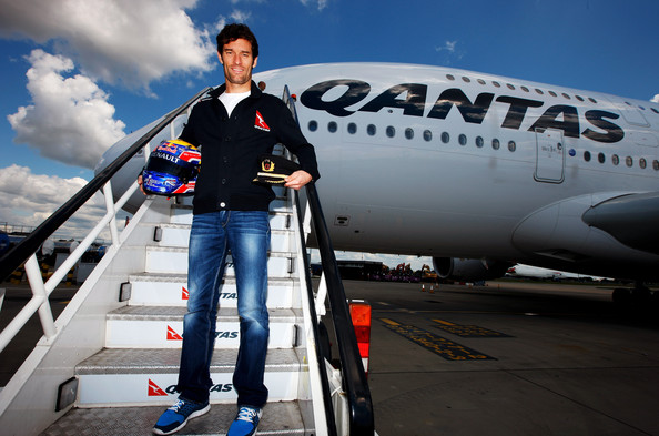 Mark Webber Australian F1 Driver & Qantas Ambassador Mark Webber poses for pictures on the steps during a media event to announce his future plans to obtain a pilots licence at Heathrow Airport on June 29, 2011 in London, England. Qantas will provide mentoring support to Webber from one of the airline's training pilots and time in the Qantas flight simulators.