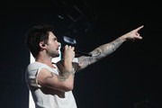 Lead singer of rock band Maroon 5, Adam Levine performs for fans at Rod Laver Arena on October 12, 2012 in Melbourne, Australia.