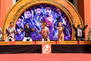 Chris Hemsworth, Chris Evans, Robert Downey Jr., Scarlett Johansson, and Mark Ruffalo pose at the Marvel Studios' 'Avengers: Endgame' Cast Place Their Hand Prints In Cement At TCL Chinese Theatre IMAX Forecourt at TCL Chinese Theatre IMAX on April 23, 2019 in Hollywood, California.