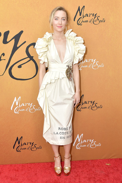 Saoirse Ronan looked romantic in an ivory ruffle cocktail dress by Gucci at the New York premiere of 'Mary Queen of Scots.'