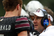 Head coach Dan Mullen of the Mississippi State Bulldogs talks with Nick Fitzgerald #7 during the second half of an NCAA football game against the Massachusetts Minutemen at Davis Wade Stadium on November 4, 2017 in Starkville, Mississippi.