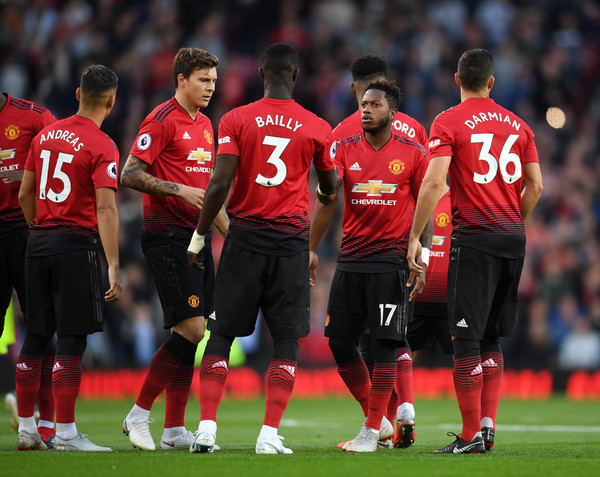 Manchester United vs. Leicester City - Premier League [player,sports,sports equipment,team sport,ball game,team,football player,soccer player,sport venue,red,fred,team mates,v,hands,manchester,united kingdom,manchester united,leicester city,premier league,match]