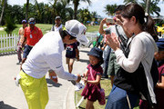 Ryo Ishikawa of Japan signs a autograph for a young fan after the third round of the Maybank Championship Malaysia at Saujana Golf and Country Club on February 3, 2018 in Kuala Lumpur, Malaysia.