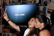 Grace Lee (L) and Adriana Lima attend Maybelline New York Celebrates New York Fashion Week at Sixty Five on September 13, 2015 in New York City.