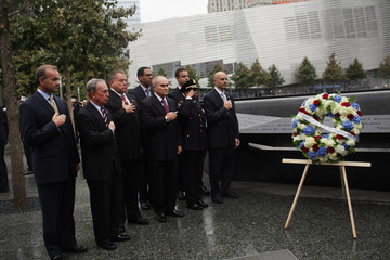 Michael Bloomberg Raymond Kelly Mayor And City Officials Lay Wreath At 9/11 Memorial In Honor Of First Responders