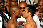 Boxers Floyd Mayweather Jr. (L) and Juan Manuel Marquez face off during their official weigh-in at the MGM Grand Garden Arena September 18, 2009 in Las Vegas, Nevada. The two will fight at the MGM on September 19.